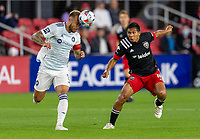 WASHINGTON, DC - MAY 13: Francisco Calvo #5 of Chicago Fire FC heads the ball away from Edison Flores #10 of D.C. United during a game between Chicago Fire FC and D.C. United at Audi FIeld on May 13, 2021 in Washington, DC.