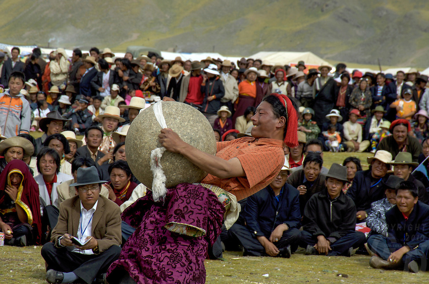 Strong man competition. In Tibet's province of Nakchu in Tibet hosts many festivals throughout the year, but one stands out more than any other; it is the highest horse racing festival in the world – a spectacle of colour, festivities and endurance for participants and visitors alike.<br /> Over 10,000 people will cross high passes of more than 4,000 metres by foot, horse and jeep to make their way to the Nakchu Racecourse, to race, eat, drink and make merry during this annual festival. This racecourse, at 4,500 metres, is undoubtedly the highest racecourse in the world.