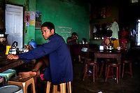 Burmese people from various ethnic backgrounds sit in a tea shop in Mawlamyine, Mon State. /Felix Features