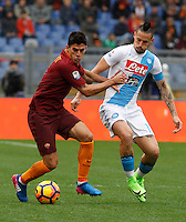 Roma's Diego Perotti, left, is challenged by Napoli's Marek Hamsik during the Italian Serie A football match between Roma and Napoli at Rome's Olympic stadium, 4 March 2017. <br /> UPDATE IMAGES PRESS/Riccardo De Luca
