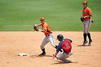 Shortstop Cam Shepherd (6) of Peachtree Ridge High School in Duluth, Georgia playing for the Baltimore Orioles scout team throws to first base as Cory Wood (2) slides in during the East Coast Pro Showcase on July 30, 2015 at George M. Steinbrenner Field in Tampa, Florida.  Second baseman Tyler Daughtry (right) backs up the play.  (Mike Janes/Four Seam Images)