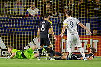 CARSON, CA - SEPTEMBER 15: Zlatan Ibrahimovic #9 of the Los Angeles Galaxy takes a scoring shot on goal past Graham Zusi #8, Graham Smith #16 and Tim Melia #29 and begins to celebrate during a game between Sporting Kansas City and Los Angeles Galaxy at Dignity Health Sports Park on September 15, 2019 in Carson, California.