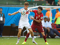 Thomas Muller of Germany and Pepe of Portugal