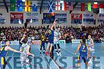 Kieran Donaghy Tralee Warriors and Pranus Skurdauskas Keanes Supervalu Killorglin contest the throw in during the Premier Mens final at St Marys Christmas Bastketball blitz on Monday night