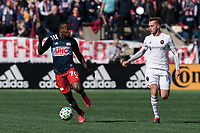 FOXBOROUGH, MA - MARCH 7: Cristian Penilla #70 of New England Revolution brings the ball forward as Djordje Mihailovic #14 of Chicago Fire closes during a game between Chicago Fire and New England Revolution at Gillette Stadium on March 7, 2020 in Foxborough, Massachusetts.