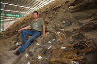 Professor Xu Xing poses at a site of dinosaur fossil in Zhecheng, Shandong province, China. 06-Jun-2012<br /> <br /> Photo by Lou Lin Wei  / sinopix