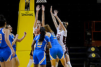 SANTA CRUZ, CA - JANUARY 22: Lacie Hull #24 amd Lexie Hull #12 go up for a block during the Stanford Cardinal women's basketball game vs the UCLA Bruins at Kaiser Arena on January 22, 2021 in Santa Cruz, California.