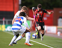 17th October 2020; Vitality Stadium, Bournemouth, Dorset, England; English Football League Championship Football, Bournemouth Athletic versus Queens Park Rangers; Rob Dickie and Osman Kakay of Queens Park Rangers tackle Adam Smith of Bournemouth