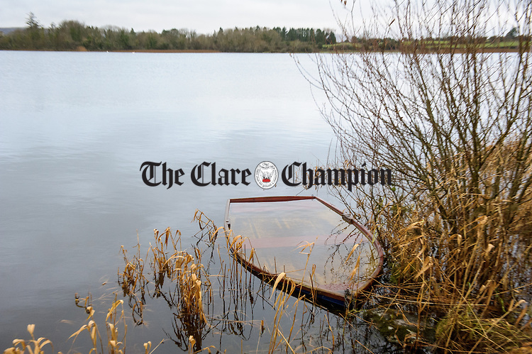 A small rowing boat is completely submerged by water at Lake Inchiquin outside Corofin. Photograph  by John Kelly.