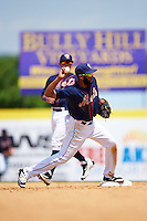 Binghamton Mets shortstop Amed Rosario (1) throws to first as L.J. Mazzilli (7) backs up the play during a game against the Richmond Flying Squirrels on June 26, 2016 at NYSEG Stadium in Binghamton, New York.  Binghamton defeated Richmond 7-2.  (Mike Janes/Four Seam Images)