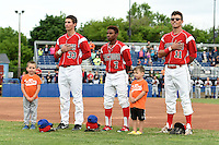 "Batavia Muckdogs players Eric Fisher (33), Mason Davis (7), and Aaron Blanton (11) stand for the national anthem with young fans as part of the ""Stars of the Game"" promotion before a game against the Mahoning Valley Scrappers on June 20, 2014 at Dwyer Stadium in Batavia, New York.  Batavia defeated Mahoning Valley 7-4.  (Mike Janes/Four Seam Images)"