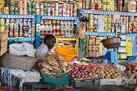 Dakar, Senegal.  Kermel Market,.  Vendor of Vegetables and Canned Goods.