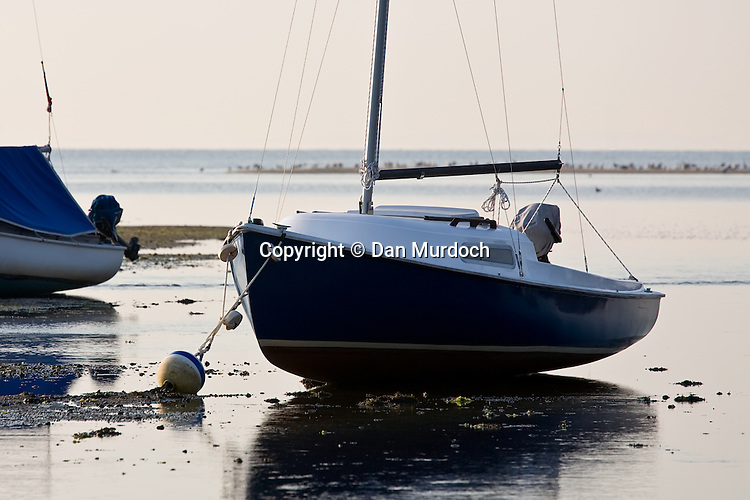 sailboat aground at low tide