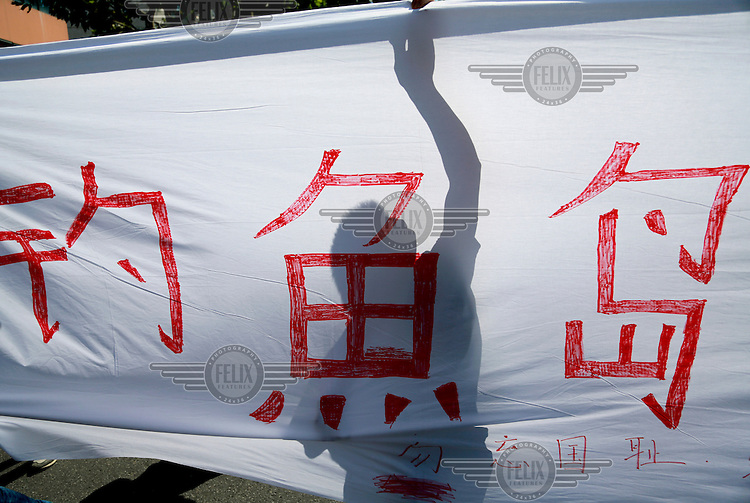 Protestors display banners while chanting slogans during a march towards the Japanese Consulate. Protests in several Chinese cities broke out against Japan as it tries to nationalise the disputed Senkaku Islands, as it is known in Japan, or Diaoyu Island as it is known in China for a second day, prompting Japanese Prime Minister Yoshihiko Noda to urge Beijing to protect his country's companies and diplomatic buildings from fresh assaults.