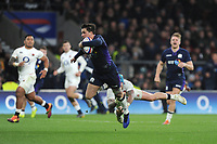 Sam Johnson of Scotland evades the tackle of Jack Nowell of England as he goes on to score a try during the Guinness Six Nations Calcutta Cup match between England and Scotland at Twickenham Stadium on Saturday 16th March 2019 (Photo by Rob Munro/Stewart Communications)