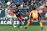 FOXBOROUGH, MA - JULY 25: Gustavo Bou #7 of New England Revolution takes a shot as Joel Waterman #16 of CF Montreal defends during a game between CF Montreal and New England Revolution at Gillette Stadium on July 25, 2021 in Foxborough, Massachusetts.