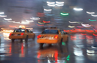 Taxis Passing Thru Herald Square on a Wet Evening, Midtown Manhattan, New York City, New York State, USA<br /> <br /> TWO SIMILARS TO THIS IMAGE ARE AVAILABLE FROM GETTY IMAGES. Please search for images # a0142-000227 and # a0142-000222 on www.gettyimages.com