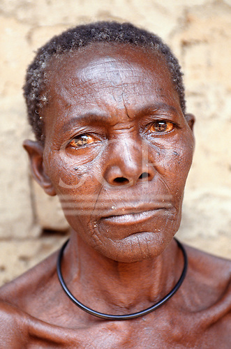 Yumba Bay, Tanzania; portrait of an old woman wearing a wooden neck bangle.
