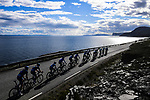 The breakaway group pass by stunning scenery during Stage 3 of the 2018 Artic Race of Norway, running 194km from Honningsvg to Hammerfest, Norway. 18th August 2018. <br /> <br /> Picture: ASO/Pauline Ballet | Cyclefile<br /> All photos usage must carry mandatory copyright credit (© Cyclefile | ASO/Pauline Ballet)