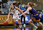 SIOUX FALLS, SD - MARCH 7: Sam Martin #21 of the UMKC Kangaroos drives agains Anna Deets #33 of the Western Illinois Leathernecks during the Summit League Basketball Tournament at the Sanford Pentagon in Sioux Falls, SD. (Photo by Dave Eggen/Inertia)