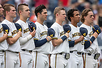 Michigan Wolverines lined up for the National Anthem before Game 11 of the NCAA College World Series against the Texas Tech Red Raiders on June 21, 2019 at TD Ameritrade Park in Omaha, Nebraska. Michigan defeated Texas Tech 15-3 and is headed to the CWS Finals. (Andrew Woolley/Four Seam Images)