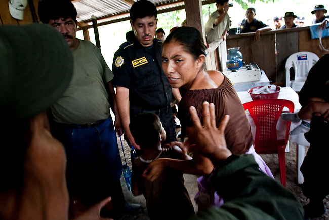 The Guatemalan police and the military evict a family from an illegal store inside the Mayan Biosphere. Most evictions target poor people working for rich land owners who return within months of the evictions.