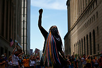 Toy Slaughter raises a first during a youth led march against police brutality and environmental racism downtown where they marched from the City County Building and throughout the city on Tuesday June 16, 2020 in Pittsburgh, Pennsylvania. (Photo by Jared Wickerham/Pittsburgh City Paper)