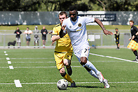 Joao Moreira of Team Wellington competes for the ball with Henry Hamilton of the Wellington Phoenix during the ISPS Handa Men's Premiership - Wellington Phoenix v Team Wellington at Fraser Park, Wellington on Saturday 14 November 2020.<br /> Copyright photo: Masanori Udagawa /  www.photosport.nz