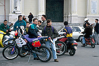 - young people in motorcycle in front of school....- giovani in motocicletta davanti a scuola