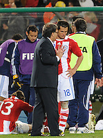 Paraguay coach Gerardo Martino and Nelson Valdez discuss tactics prior to the start of extra time. Japan and Paraguay played in the second round of the 2010 FIFA World Cup in Loftus Versfeld Stadium, in Pretoria, South Africa, June 29th. After regulation and extra time ended 0-0, Paraguay advanced to the quarterfinals, 5-3, in a penalty-kick shootout.