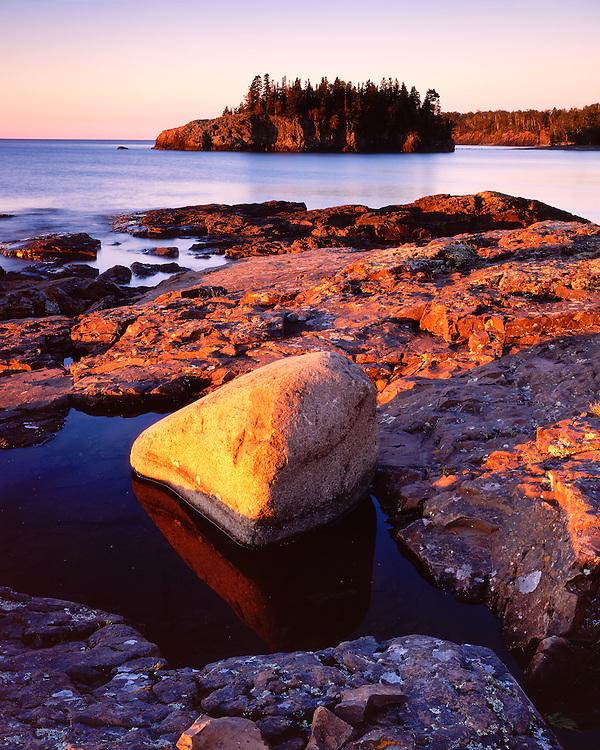 Sunset light on the shore of Lake Superior;  Splitrock Lighthouse State Park, MN
