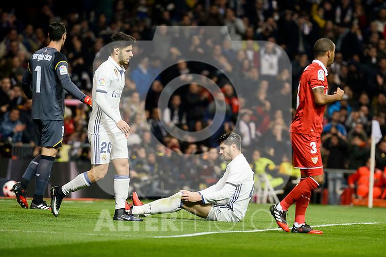 Real Madrid's Marco Asensio and Alvaro Morata and Sevilla FC's Sergio Rico and Mariano Ferreira during Copa del Rey match between Real Madrid and Sevilla FC at Santiago Bernabeu Stadium in Madrid, Spain. January 04, 2017. (ALTERPHOTOS/BorjaB.Hojas)
