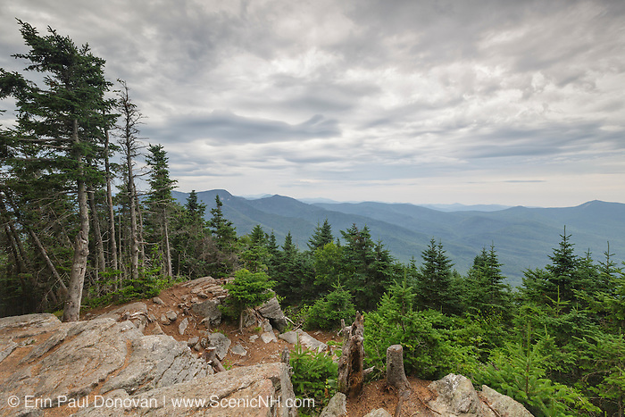 July 2016 - Storm clouds over the White Mountain National Forest from Mount Tecumseh in Waterville Valley, New Hampshire. The viewpoint seen here is from hikers doing unauthorized tree cutting. Tecumseh is named for the great Shawnee war chief, Tecumseh (1768–1813).