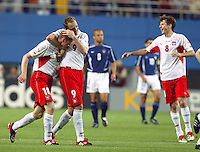 Polish players celebrate their goal. The USA lost 3-1 against Poland in the FIFA World Cup 2002 in Korea on June 14, 2002.