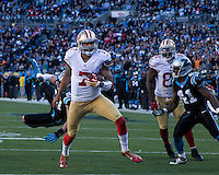 The Carolina Panthers played the San Francisco 49ers at Bank of America Stadium in Charlotte, NC in the NFC divisional playoffs on January 12, 2014.  The 49ers won 23-10.  San Francisco 49ers quarterback Colin Kaepernick (7)