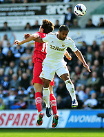 Pictured: Swansea's Wayne Routledge (R) winning the header.<br /> Saturday 20 April 2013<br /> Re: Barclay's Premier League, Swansea City FC v Southampton at the Liberty Stadium, south Wales.