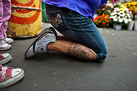 A Mexican worshipper of Santa Muerte (Saint Death), after crawling long journey on her knees, reaches the shrine in Tepito, a rough neighborhood of Mexico City, Mexico, 1 June 2011. The religious cult of Santa Muerte is a syncretic fusion of Aztec death worship rituals and Catholic beliefs. Born in lower-class neighborhoods of Mexico City, it has always been closely associated with crime. In the past decades, original Santa Muerte's followers (such as prostitutes, pickpockets and street drug traffickers) have merged with thousands of ordinary Mexican Catholics. The Saint Death veneration, offering a spiritual way out of hardship in the modern society, has rapidly expanded. Although the Catholic Church considers the Santa Muerte's followers as devil worshippers, on the first day of every month, crowds of believers in Saint Death fill the streets of Tepito. Holding skeletal figurines of Holy Death clothed in a long robe, they pray for power healing, protection and favors and make petitions to 'La Santísima Muerte', who reputedly can make life-saving miracles.