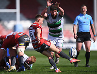24th April 2021; Kingsholm Stadium, Gloucester, Gloucestershire, England; English Premiership Rugby, Gloucester versus Newcastle Falcons; Stephen Varney of Gloucester kicks under pressure from Greg Peterson of Newcastle Falcons