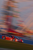 Rolex 24 at Daytona, Daytona International Speedway 5/6 Feb, 2005.The #44 Lexus Doran races past the ferris wheel..Copyright©F.Peirce Williams 2005
