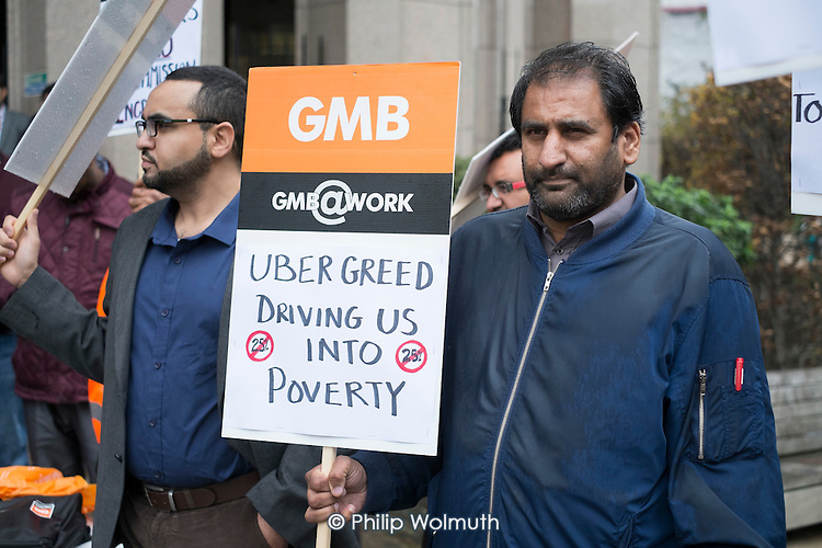 GMB London Uber drivers protest at increased commission rates and price cuts outside Uber London HQ.