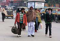 India, Dehradun. Indian Men and Woman Walking on a Cold February Morning.