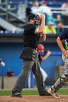 Umpire Ryan Wilhelms makes a call during a game between the Vermont Lake Monsters and Batavia Muckdogs August 9, 2015 at Dwyer Stadium in Batavia, New York.  Vermont defeated Batavia 11-5.  (Mike Janes/Four Seam Images)