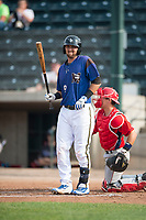 Missoula Osprey catcher Zachery Almond (9) at bat in front of catcher Griffin Barnes (28) during a Pioneer League game against the Orem Owlz at Ogren Park Allegiance Field on August 19, 2018 in Missoula, Montana. The Missoula Osprey defeated the Orem Owlz by a score of 8-0. (Zachary Lucy/Four Seam Images)