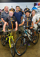 Phillip Johnson, left,  Joshua Johnson, age 13, Harlem Tamatea, age 12, and Martha Tamatea  receive their new bikes from Scott Guyton, centre, Kiwivelo bike presentation at Kiwivelo Cycling, Takapuna, New Zealand on Saturday, 7 November 2015. Photo: David Rowland / lintottphoto.co.nz
