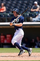 Brent Morel #28 of the Charlotte Knights follows through on his swing against the Norfolk Tides at Knights Stadium July 5, 2010, in Fort Mill, South Carolina.  Photo by Brian Westerholt / Four Seam Images