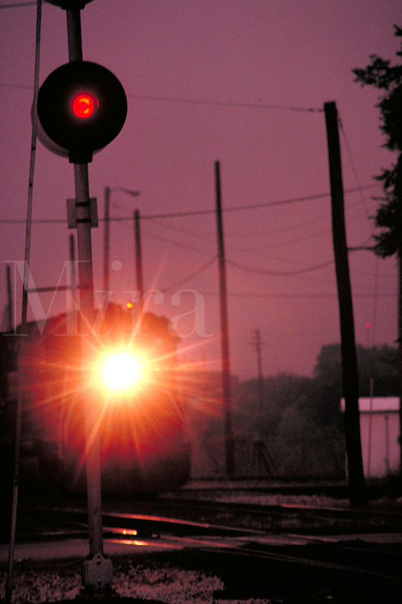 Train's headlight shown approaching signal light. Houston Texas USA Hardy Street Engine Facility.