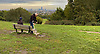Man on crutches decides to leave. View of the City from Hampstead Heath, N London.<br />