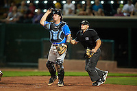Hudson Valley Renegades catcher Taylor Hawkins (15) and umpire Greg Roemer keep an eye on the ball during a game against the Vermont Lake Monsters on September 3, 2015 at Centennial Field in Burlington, Vermont.  Vermont defeated Hudson Valley 4-1.  (Mike Janes/Four Seam Images)