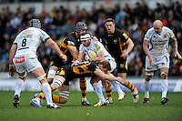 Luke Arscott of Exeter Chiefs is tackled by Marco Wentzel (scrum cap) and Sam Jones of London Wasps during the Aviva Premiership match between London Wasps and Exeter Chiefs at Adams Park on Sunday 21st April 2013 (Photo by Rob Munro)