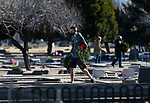 As part of National Wreaths Across America Day, volunteers, including Zachary Homola, place wreaths on the graves of veterans at the Lone Mountain Cemetery, in Carson City, Nev., on Saturday, Dec. 19, 2020. The program honors veterans at more than 2100 cemeteries around the world. <br /> Photo by Cathleen Allison/Nevada Momentum Fueled by RAD